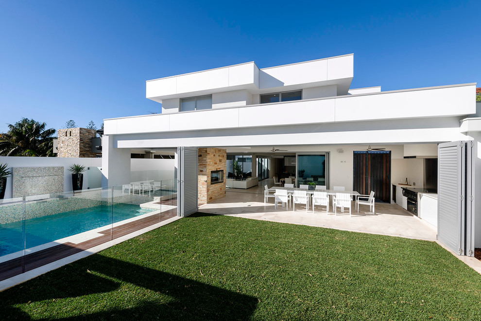 Example of a large trendy white exterior home design in Perth