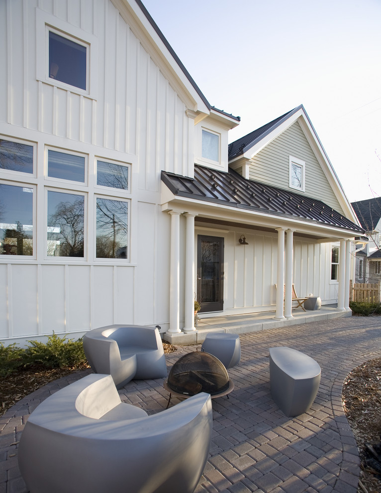 Example of a cottage white two-story wood exterior home design in Minneapolis with a metal roof
