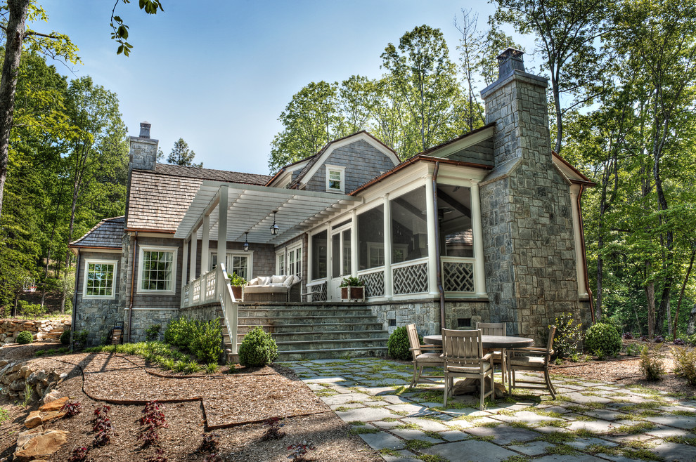 Mid-sized victorian gray two-story wood house exterior idea in Other with a gambrel roof and a shingle roof