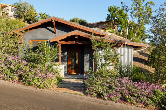 Example of a small mountain style gray one-story mixed siding gable roof design in Santa Barbara