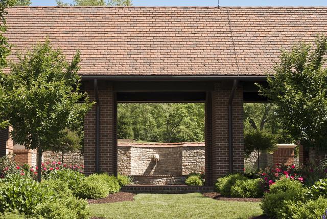Country house brick loggia traditional exterior for Garden loggia designs