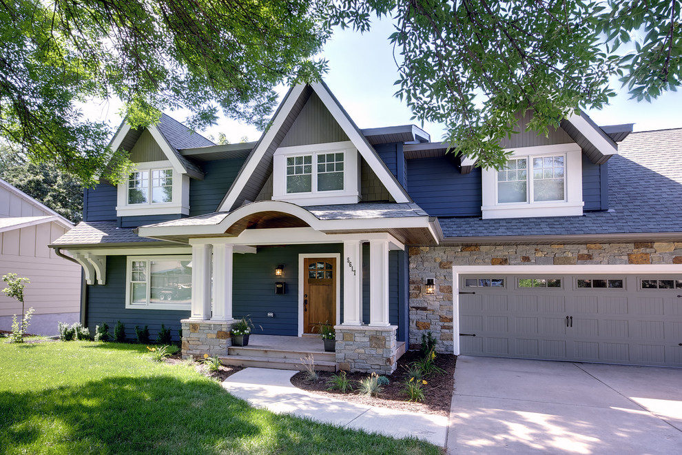 Inspiration for a mid-sized timeless two-story wood exterior home remodel in Minneapolis