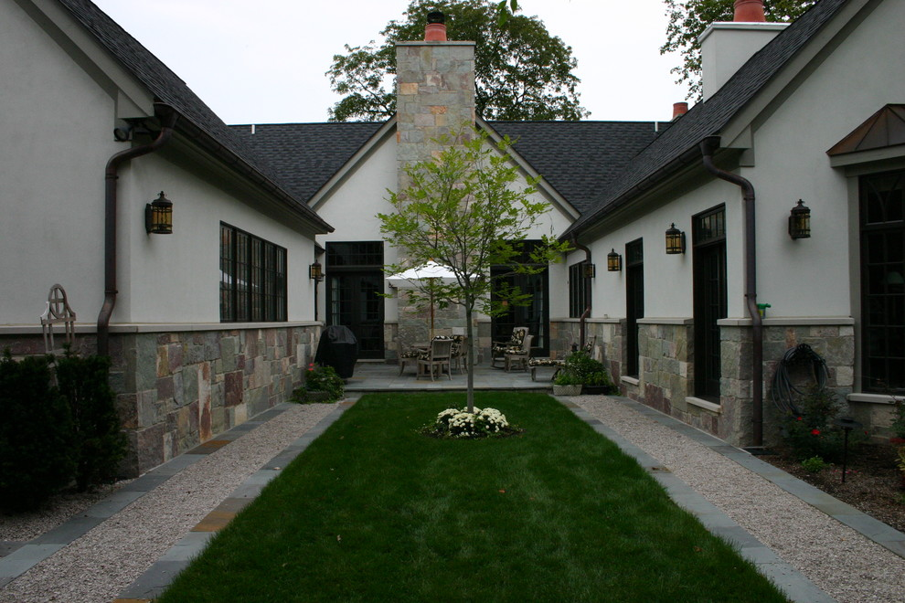 Inspiration for a timeless one-story mixed siding exterior home remodel in Detroit