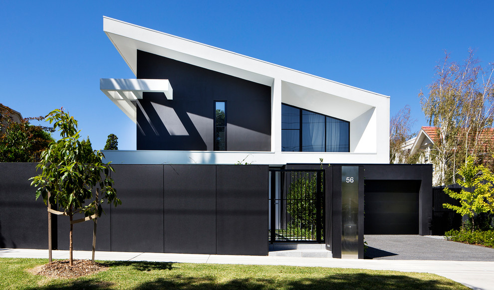 Contemporary black two-story house exterior idea in Melbourne with a shed roof