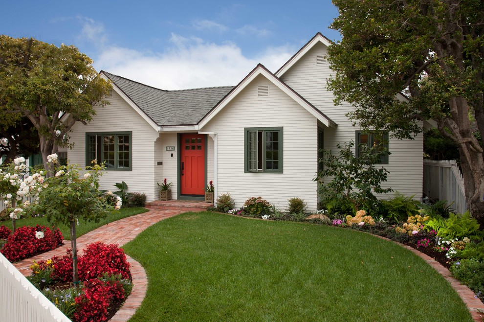 Small elegant white one-story wood exterior home photo in San Diego with a shingle roof