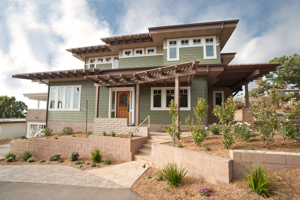 Inspiration for a mid-sized transitional green two-story wood flat roof remodel in San Diego