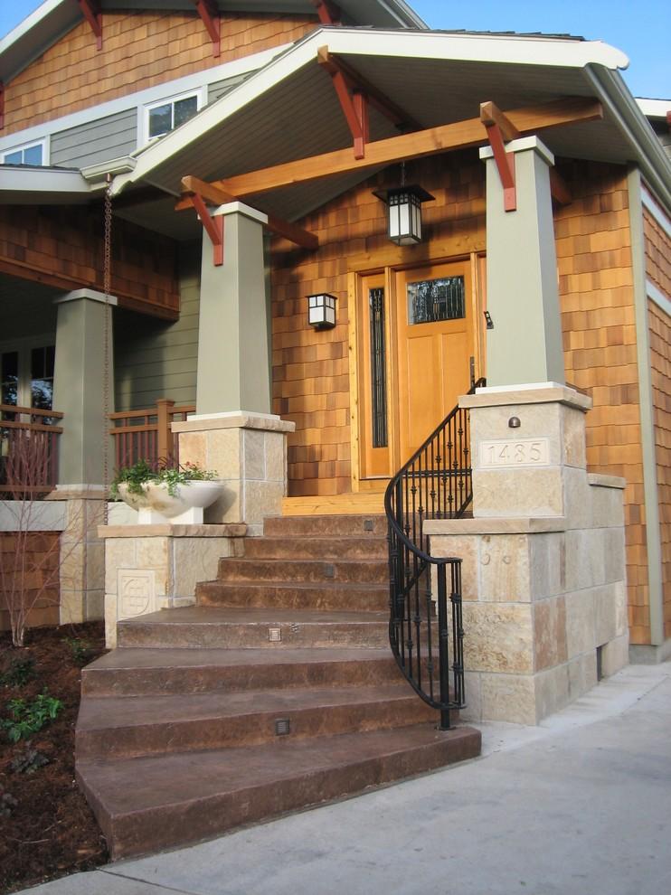 Inspiration for a craftsman wood exterior home remodel in Denver
