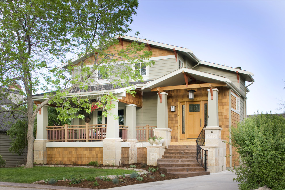 Example of an arts and crafts wood exterior home design in Denver