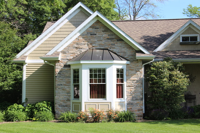 Example of an arts and crafts wood exterior home design in Chicago