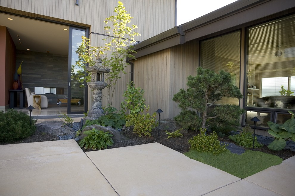 Example of a trendy wood exterior home design in Portland