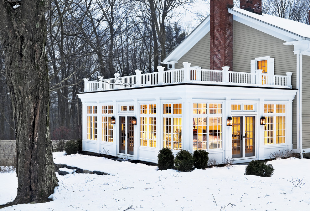 Elegant two-story wood exterior home photo in New York
