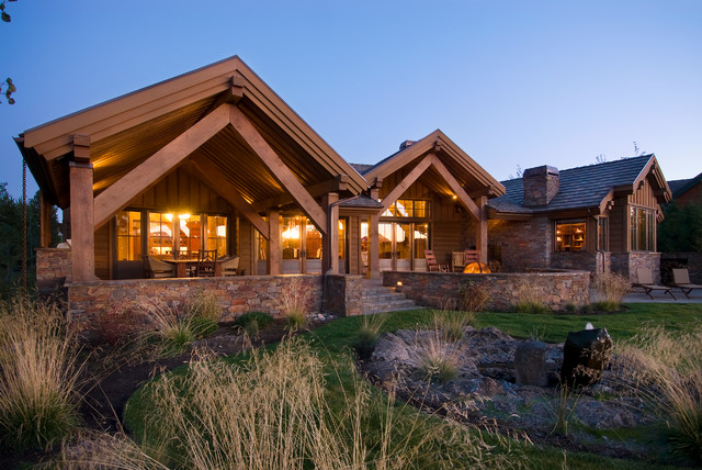 Example Of A Mountain Style Brown One Story Exterior Home Design In Portland