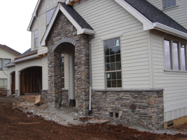 Cultured stone veneer exterior traditional exterior for Brick and stone veneer