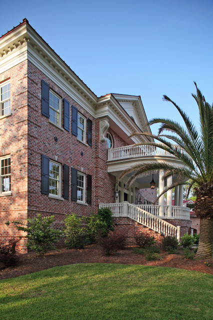 Curved front porch gives balance to this Georgian Façade traditional-exterior