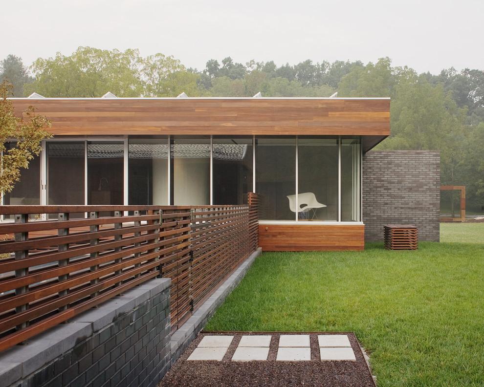 Trendy wood exterior home photo in Kansas City