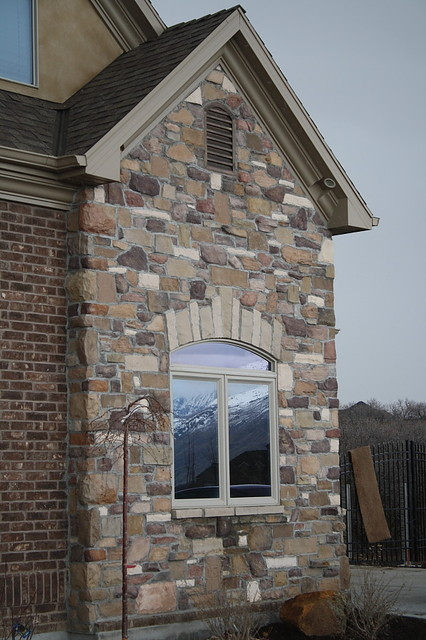 Custom blend cultured stone traditional exterior salt lake city by npw stone masonry for Exterior window trim for brick home