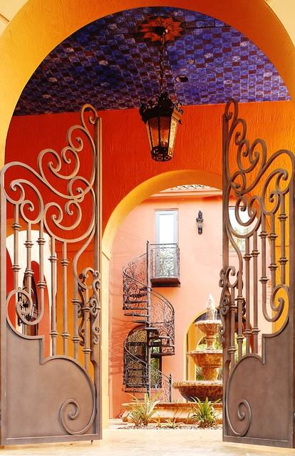 Custom Courtyard Gates & Spiral Stairs mediterranean-exterior