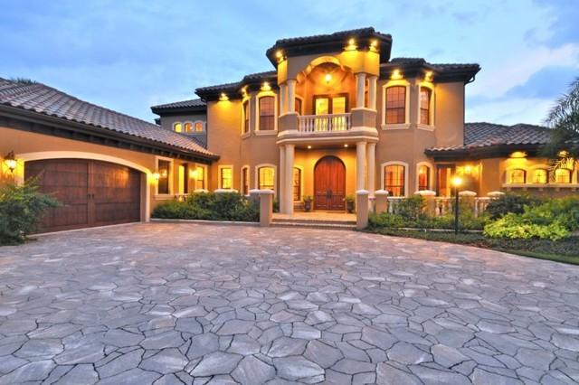 Custom home design by brista homes mediterranean for Custom home exterior design