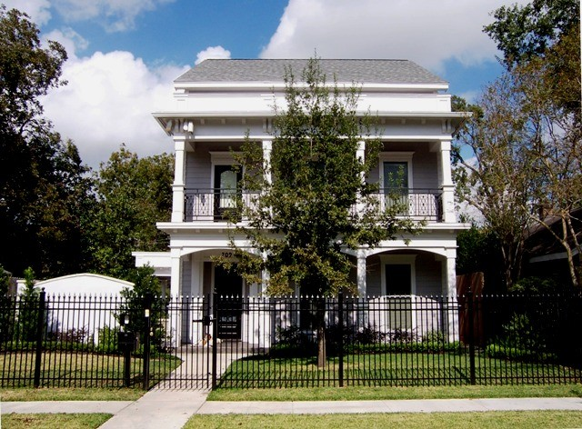 Mid-sized ornate white two-story vinyl exterior home photo in Houston