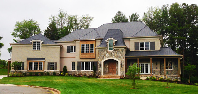 Huge farmhouse beige two-story brick exterior home photo in DC Metro