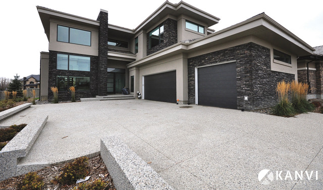 Black garage doors with brick - Custom Houses Contemporary Exterior Edmonton By Kanvi Homes
