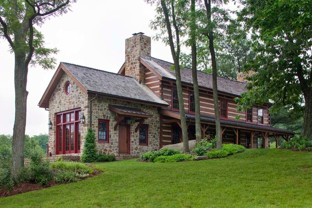 Custom log home with stone rustic exterior by for Custom rustic homes