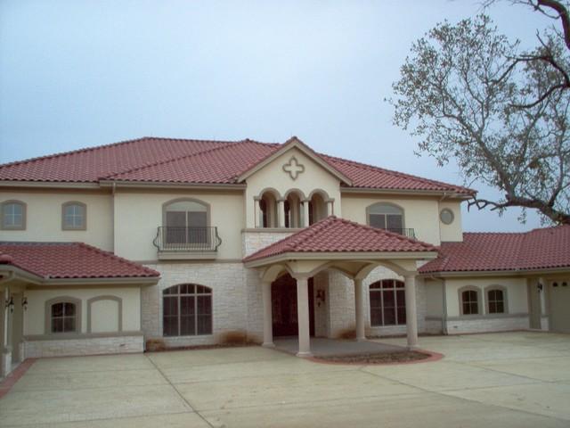 Custom mediterranean style home mediterranean exterior for Custom home exterior design
