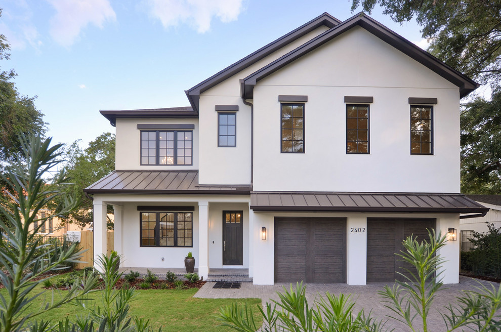 Transitional white two-story exterior home photo in Tampa with a metal roof