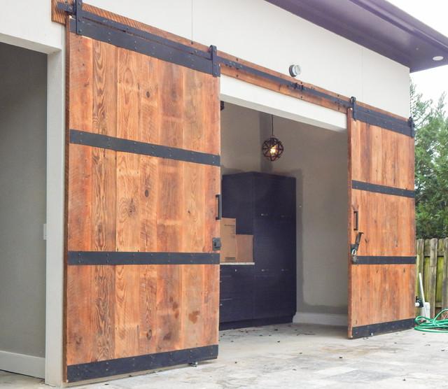 custom pool house barn doors industrial exterior