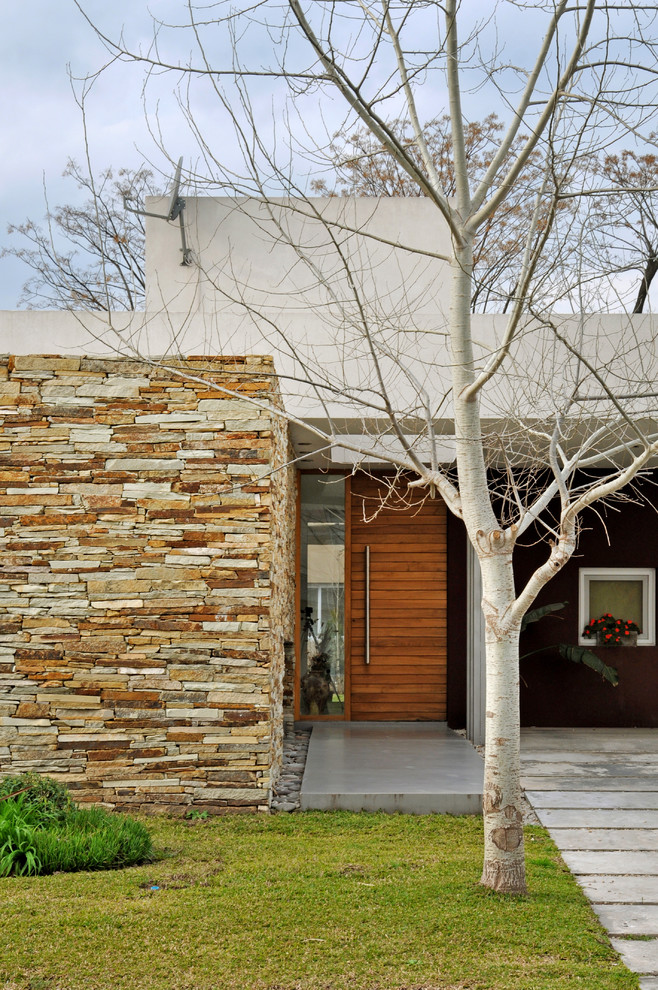 Minimalist mixed siding exterior home photo in Other
