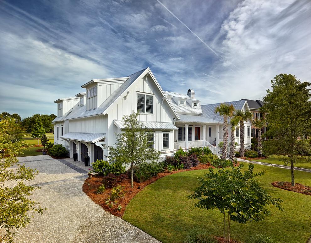 Coastal white exterior home idea in Charleston
