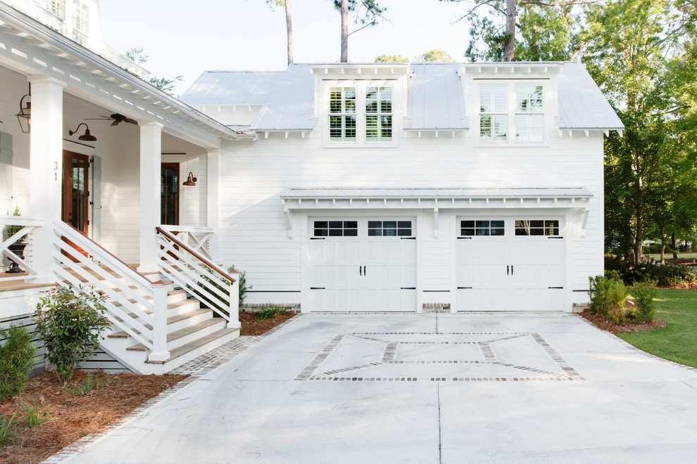 Inspiration for a farmhouse white two-story wood exterior home remodel in Charleston with a metal roof