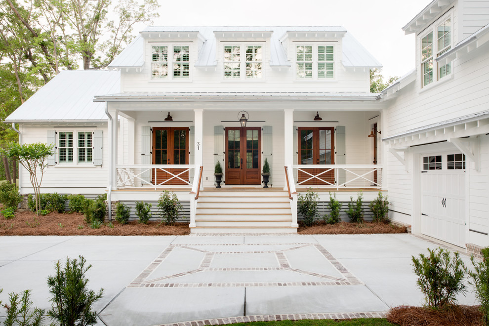 Farmhouse white two-story wood house exterior idea in Charleston with a metal roof and a white roof