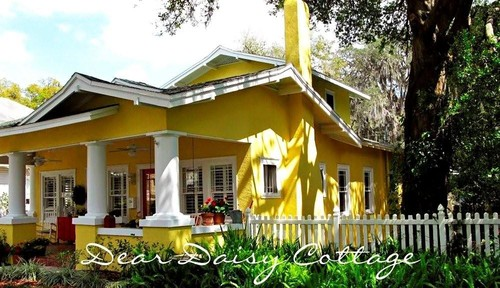 Colorful Cottage Decorating Ideas in red,yellow,blue,black & white, Fall in love with this bright yellow Bungalow filled with happy cottage decorating ideas.