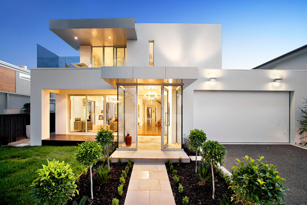 Inspiration for a contemporary two-storey white exterior in Melbourne with a flat roof.