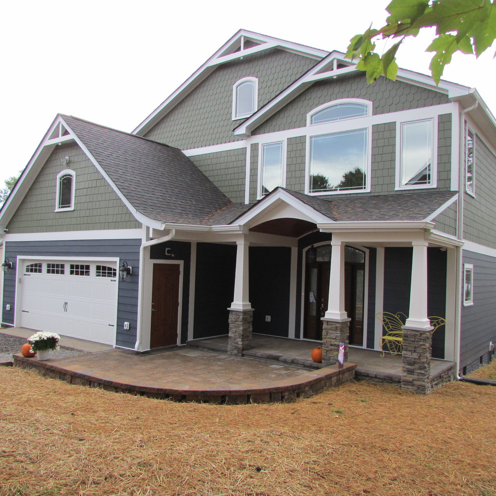 Huge craftsman multicolored two-story concrete fiberboard exterior home idea in Other with a shingle roof
