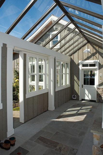 Detail of glass connector featuring sliding barn door, to control wind. traditional exterior