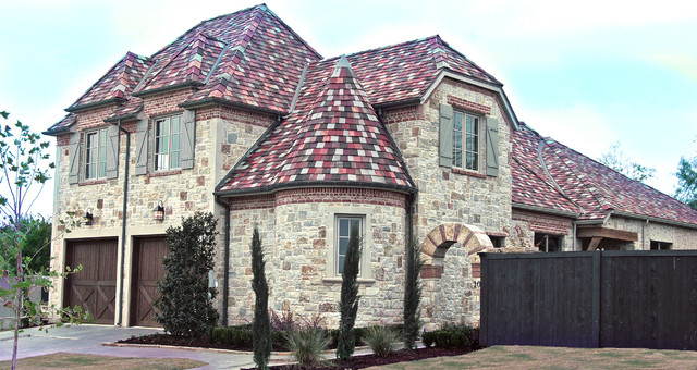 Inspiration for a mid-sized mediterranean two-story stone exterior home remodel in Dallas