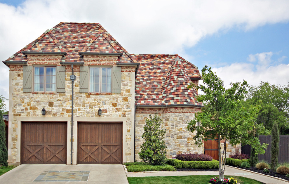 Example of a mid-sized tuscan gray one-story stucco exterior home design in Dallas