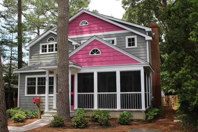 Mid-sized transitional pink two-story mixed siding exterior home idea in Other with a shingle roof