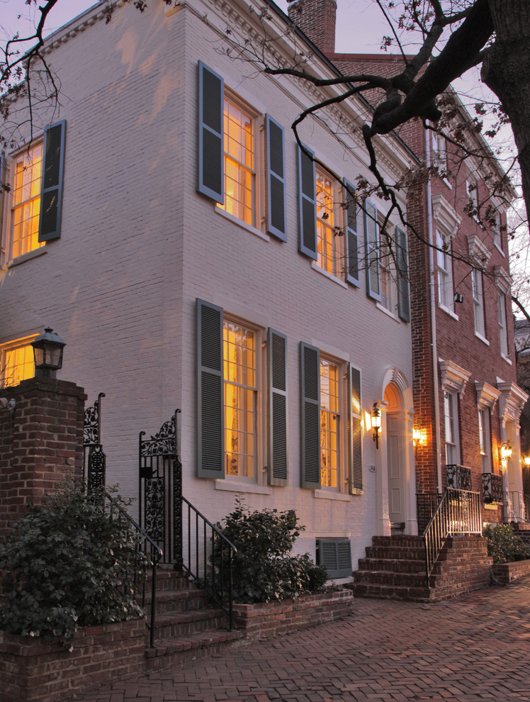 Mid-sized traditional white two-story brick townhouse exterior idea in Baltimore