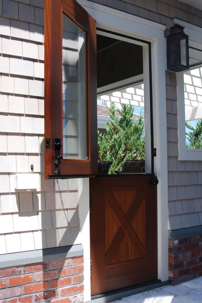 Elegant beige one-story wood exterior home photo in Philadelphia