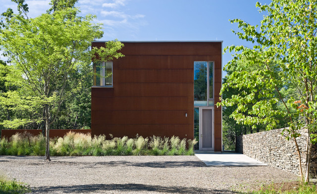 Industrial Exterior by Wagner HodgsonModern Home Exteriors Turn a Corner With Mixed Materials. Modern Home Exterior Materials. Home Design Ideas