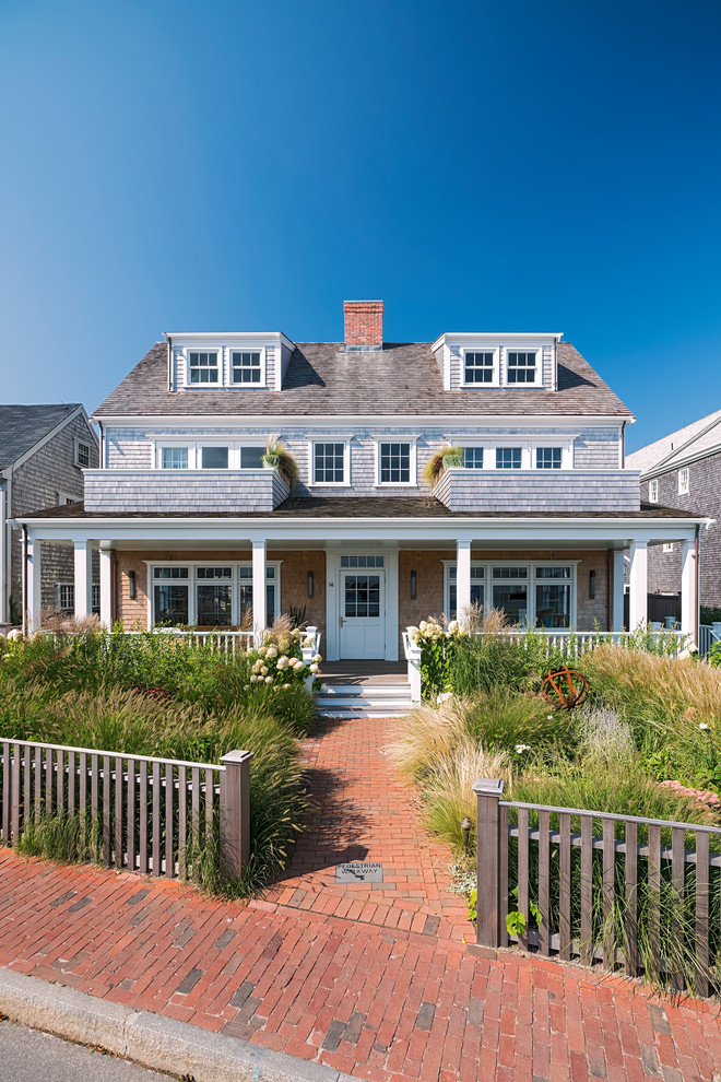 Coastal brown two-story exterior home idea in Other with a shingle roof
