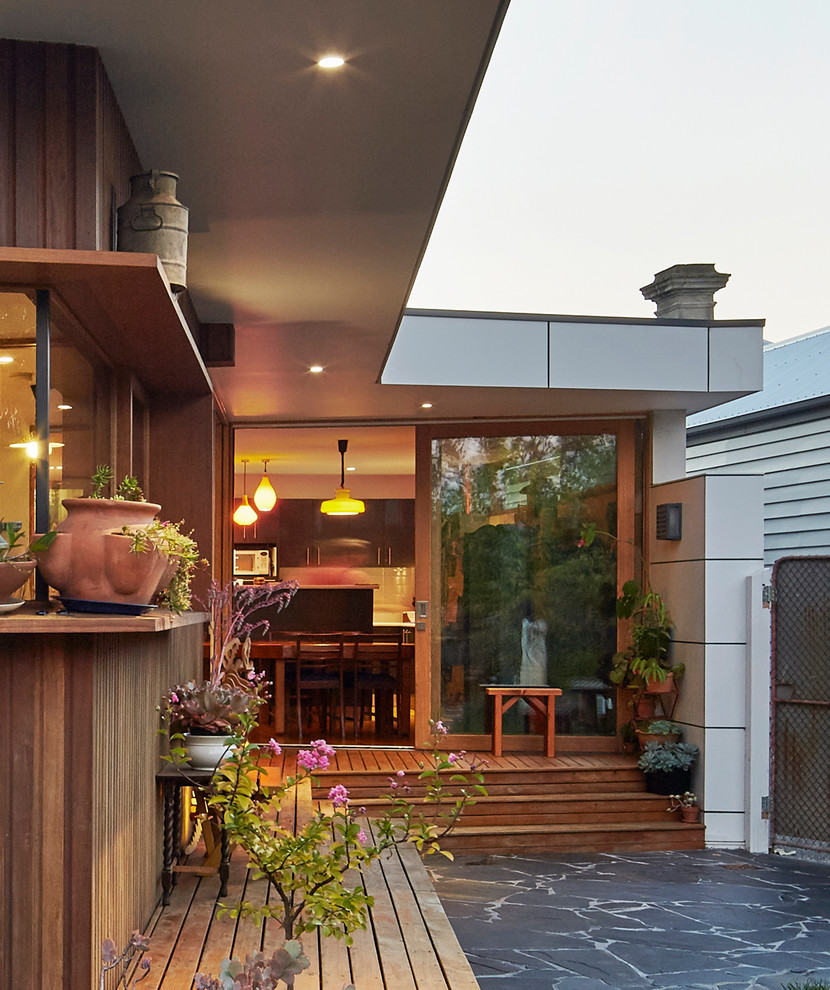 Mid-sized trendy white one-story wood flat roof photo in Melbourne