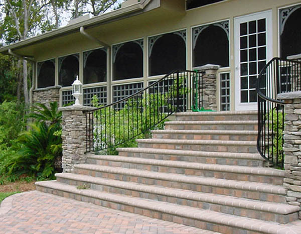 Elegant custom curved exterior stair rail with straight pickets ...