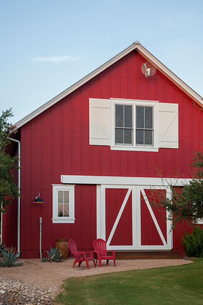 Inspiration for a farmhouse red gable roof remodel in Austin
