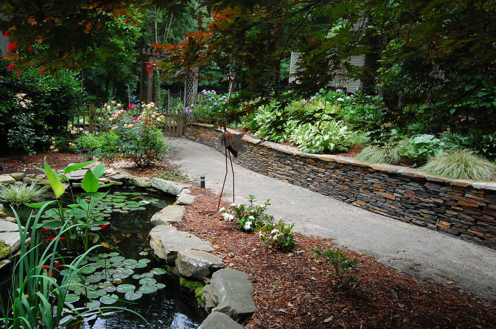 Elegant stone wall and pond
