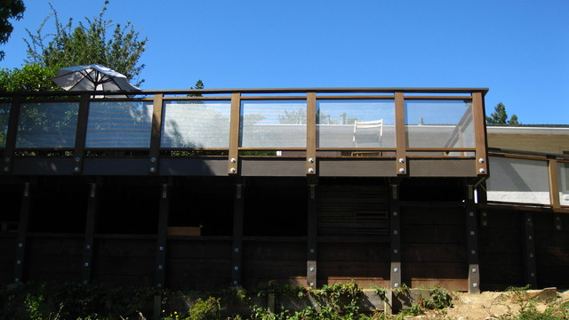 elevated deck/retaining wall with perforated metal panels contemporary exterior