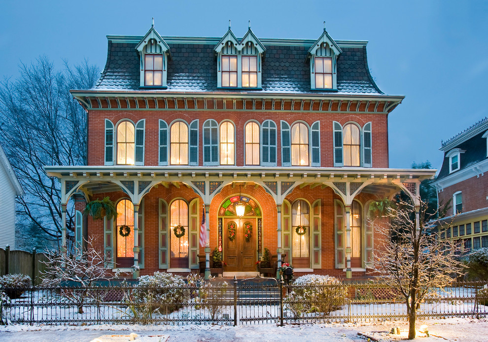 Large victorian three-story brick exterior home idea in Philadelphia
